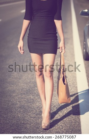 beautiful  brunette sexy leg woman black dress sunglasses, leather bag, slim body, instagram filter style, shallow depth of field background concept