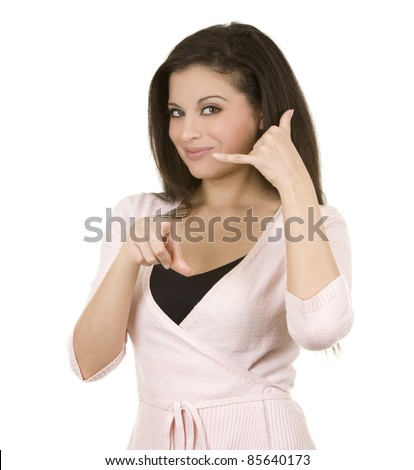 beautiful brunette showing call me sign on white background