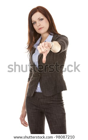 beautiful brunette showing sign thumbs down on white background
