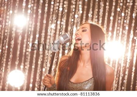 Beautiful brunette singing