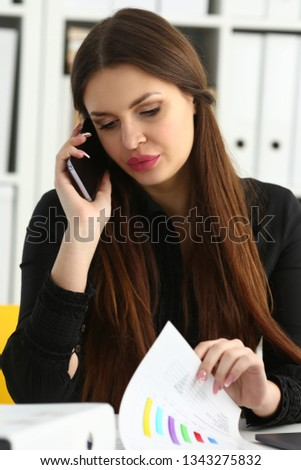 Beautiful brunette smiling businesswoman hold in arm cellphone in office workplace portrait. Stay in touch negotiate meeting job white collar busy life style electronic device store training concept