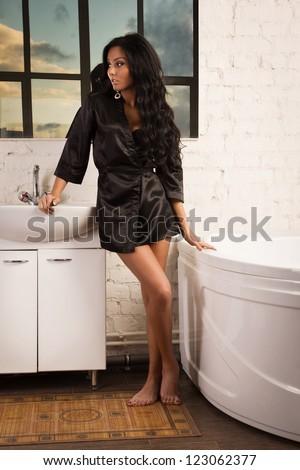 Beautiful brunette spa woman in the bathroom