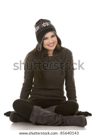 beautiful brunette wearing winter outfit on white background