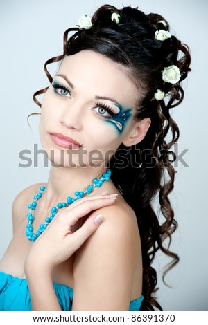 Beautiful brunette with amazing  hairstyle.The bride in the blue dress