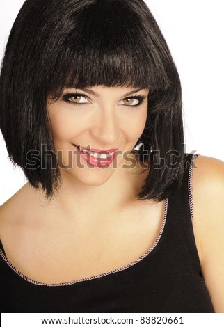 Beautiful brunette with bob hairstyle smiling and looking at camera, isolated on white background