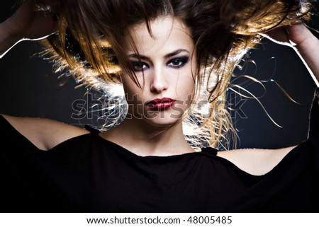 beautiful brunette with hair up, studio shot