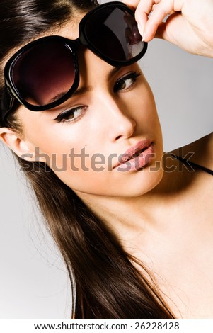 beautiful brunette with sunglasses portrait