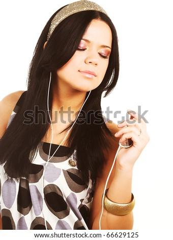 beautiful brunette woman and music - stock photo