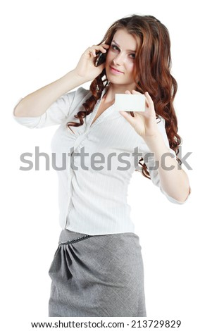 Beautiful brunette woman hold out blank card and speaking mobile phone isolated on white background #213729829