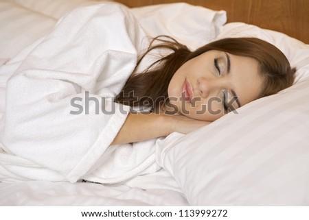 beautiful brunette woman in bed