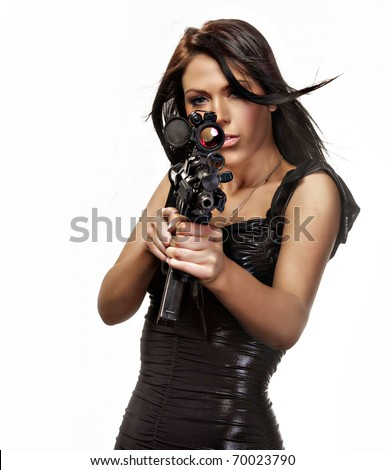 Beautiful brunette woman in black dress aiming weapon.  Image isolated against white background.