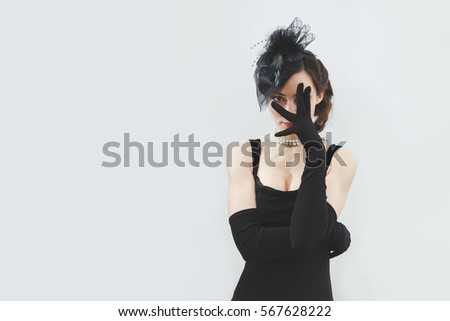 52716a4ad Young brunette woman in black gloves Images and Stock Photos - Page ...
