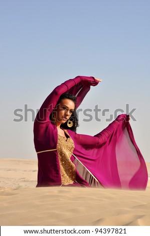 Beautiful brunette woman in desert. Dubai. United Arab Emirates.