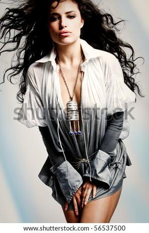 beautiful brunette woman in elegant shirt, studio shot