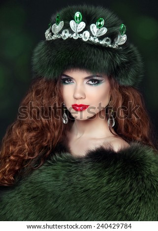 Beautiful brunette woman in mink fur coat. Jewelry. Fashion Beauty girl model with long healthy wavy hair styling.