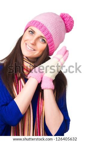 Beautiful brunette woman in winter clothes. Studio shot.