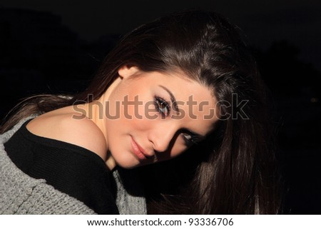 beautiful brunette woman night portrait, outdoor