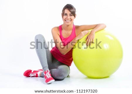 Beautiful brunette woman practicing fitness