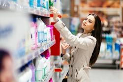Beautiful  brunette woman shopping in supermarket