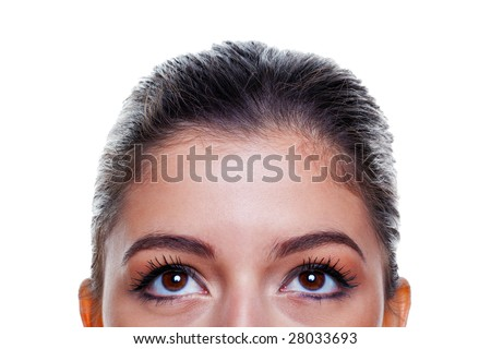 Beautiful brunette woman with big brown eyes looking upwards, isolated on white background.