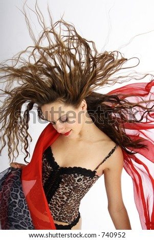 Beautiful brunette woman with blowing hairs and foulards
