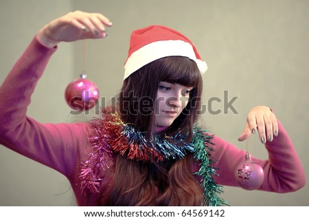 beautiful brunette woman with christmas ball