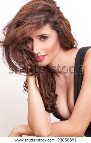 Beautiful brunette woman with elegant black dress. Fashion photo