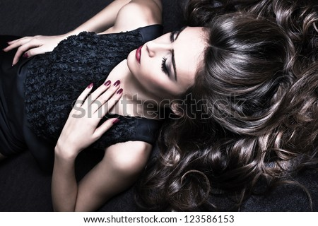 beautiful brunette woman with long healthy shiny hair and perfect makeup