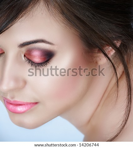 smokey eyes close up. woman with pink smoky eyes