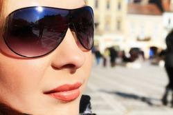 Beautiful brunette woman with sunglasses.