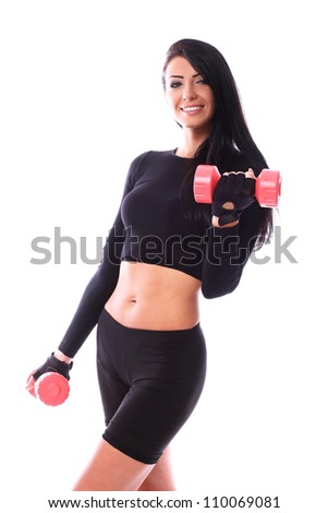 Beautiful brunette working out with dumbbells over white background