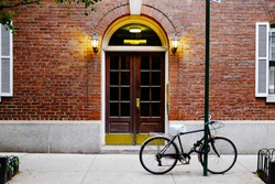 Beautiful building in Soho district. Entrance door and bicycle, Manhattan New York USA. Classic apartment building in New York City. Beautiful american street.