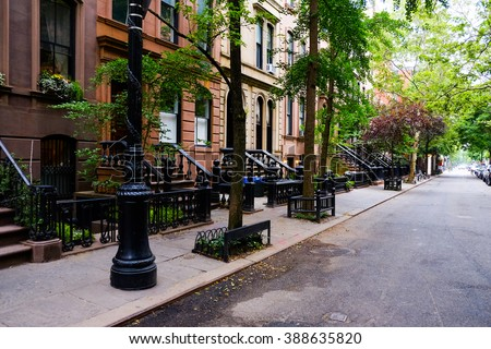 Beautiful buildings in Greenwich Village, Soho district. Entrance doors with stairs and trees, Manhattan New York. Classic luxury apartment building in New York City. Beautiful american street. #388635820