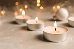 Beautiful burning wax candle on table, closeup