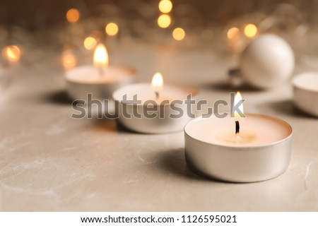 Beautiful burning wax candle on table, closeup #1126595021