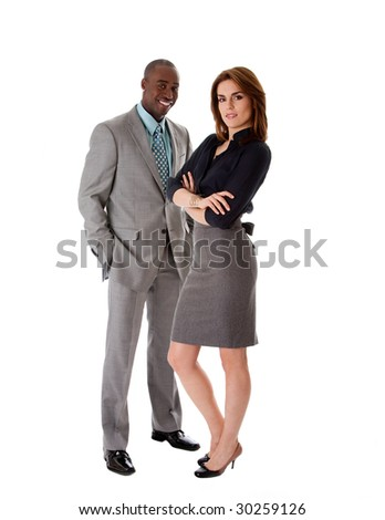 Beautiful business couple African American man and Caucasian woman standing, isolated