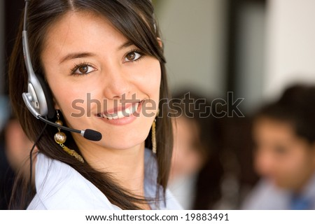 beautiful business customer service woman smiling in an office