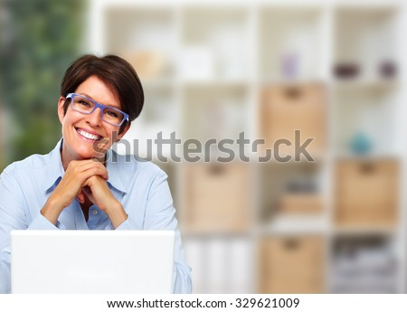 Beautiful business lady with laptop computer in office. stock photo