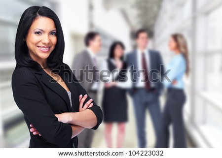 Beautiful business woman and a group of person.