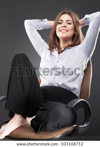 Beautiful business woman [ bank employee ] portrait sitting in chair. Relaxing female office worker