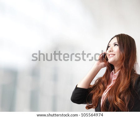Beautiful Business woman happy speak mobile phone and loo to copy space at office, model is a asian beauty - stock photo