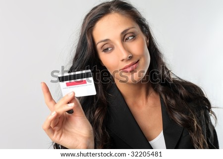 beautiful business woman holding credit card