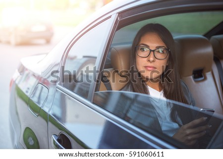 Beautiful business woman in car.