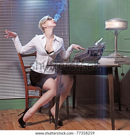 Beautiful business woman is working at the office. Retro photo style