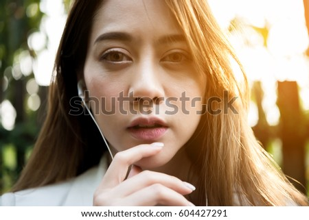 beautiful business woman listening music for relax from work #604427291