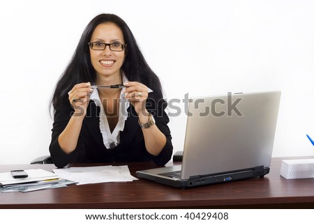 Beautiful business woman on a desktop over white