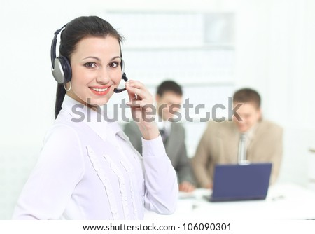 Beautiful business woman operator in the office with his team.