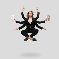 Beautiful business woman, secretary, multi-armed manager levitating isolated on grey studio background. Multi-task worker like Shiva. Concept of business, deadline, balance, time management.
