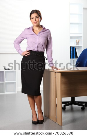 Beautiful business woman standing in the office