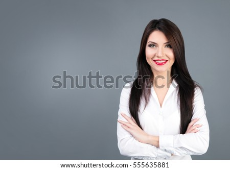 Beautiful business woman studio portrait on gray backgroung #555635881